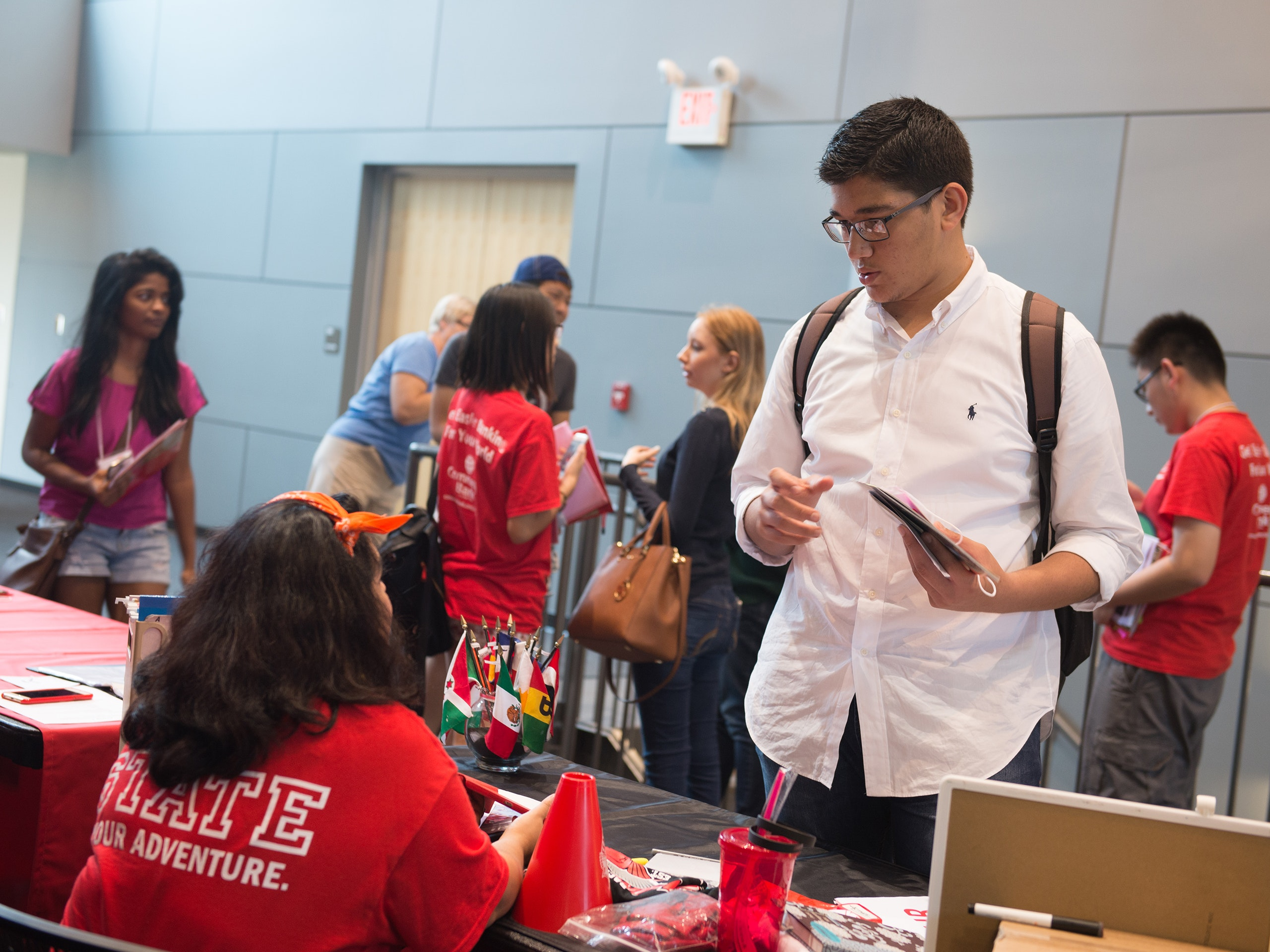 International students at a registration table.