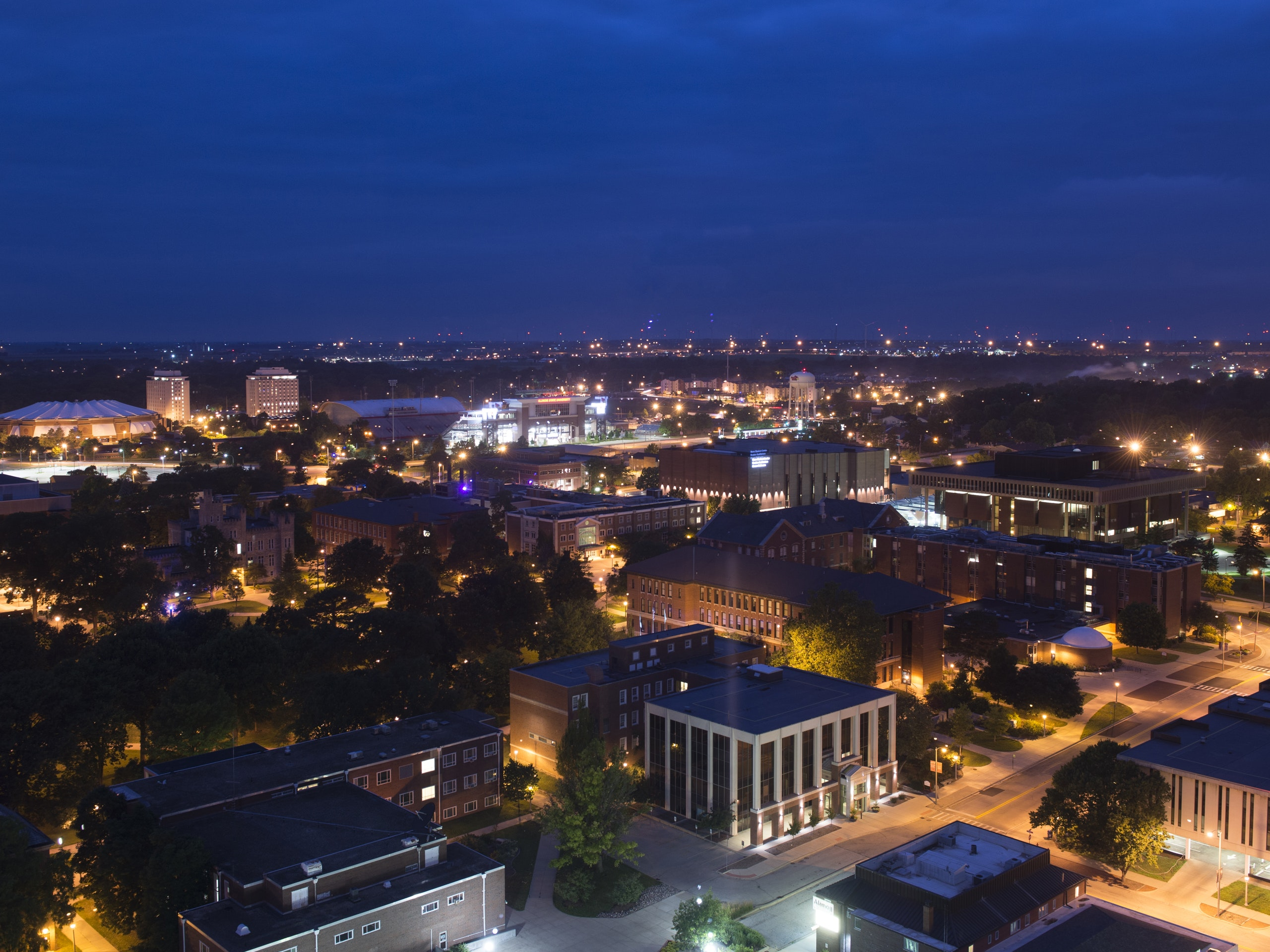Aerial view of campus at night.