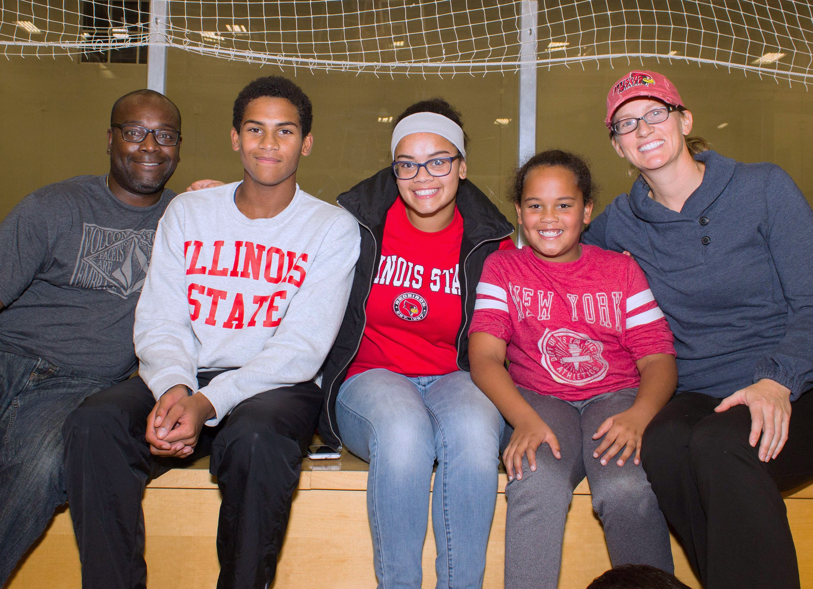 Family of five wearing Illinois State gear.