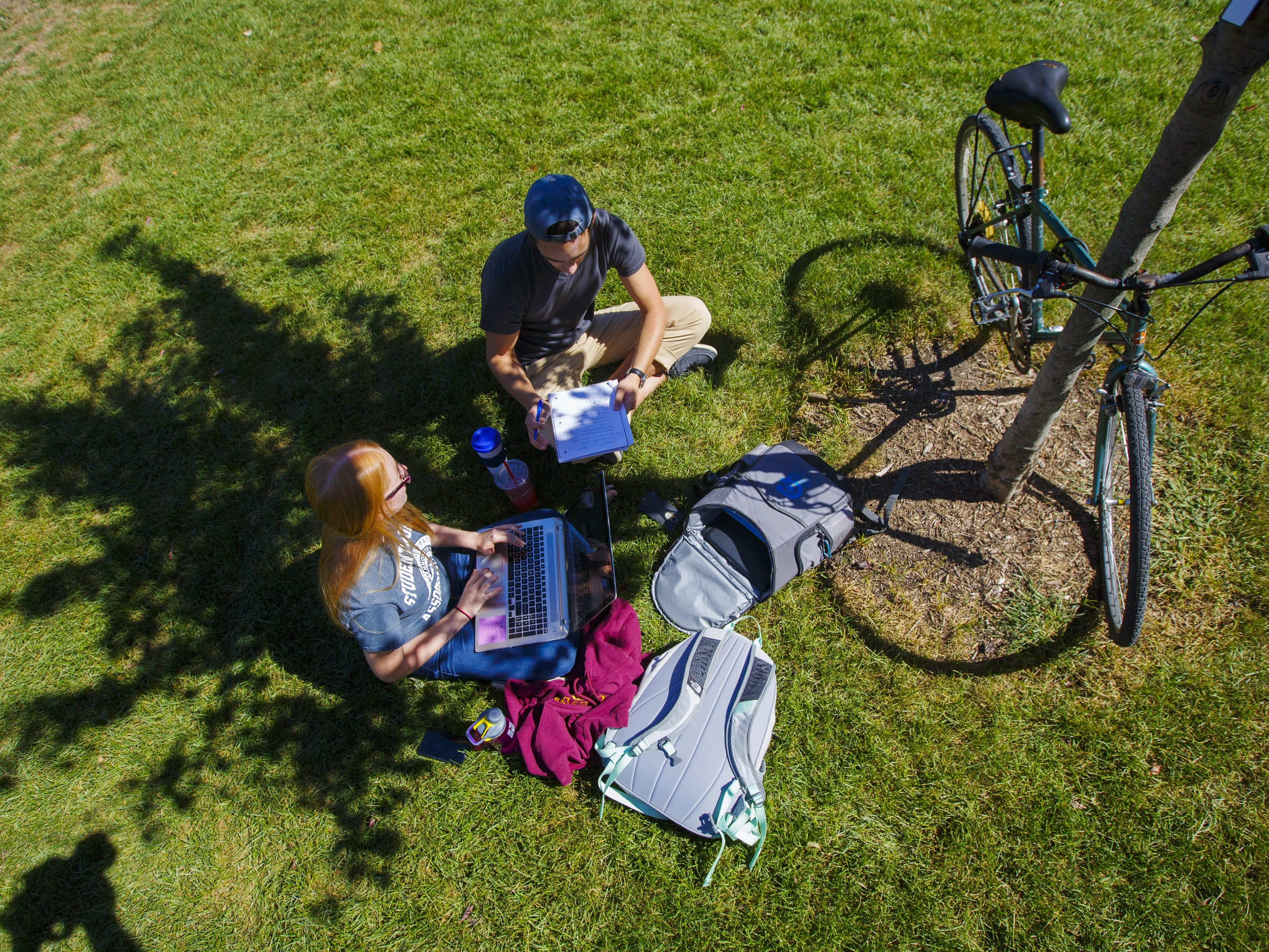 Aerial view of students studying on the quad.