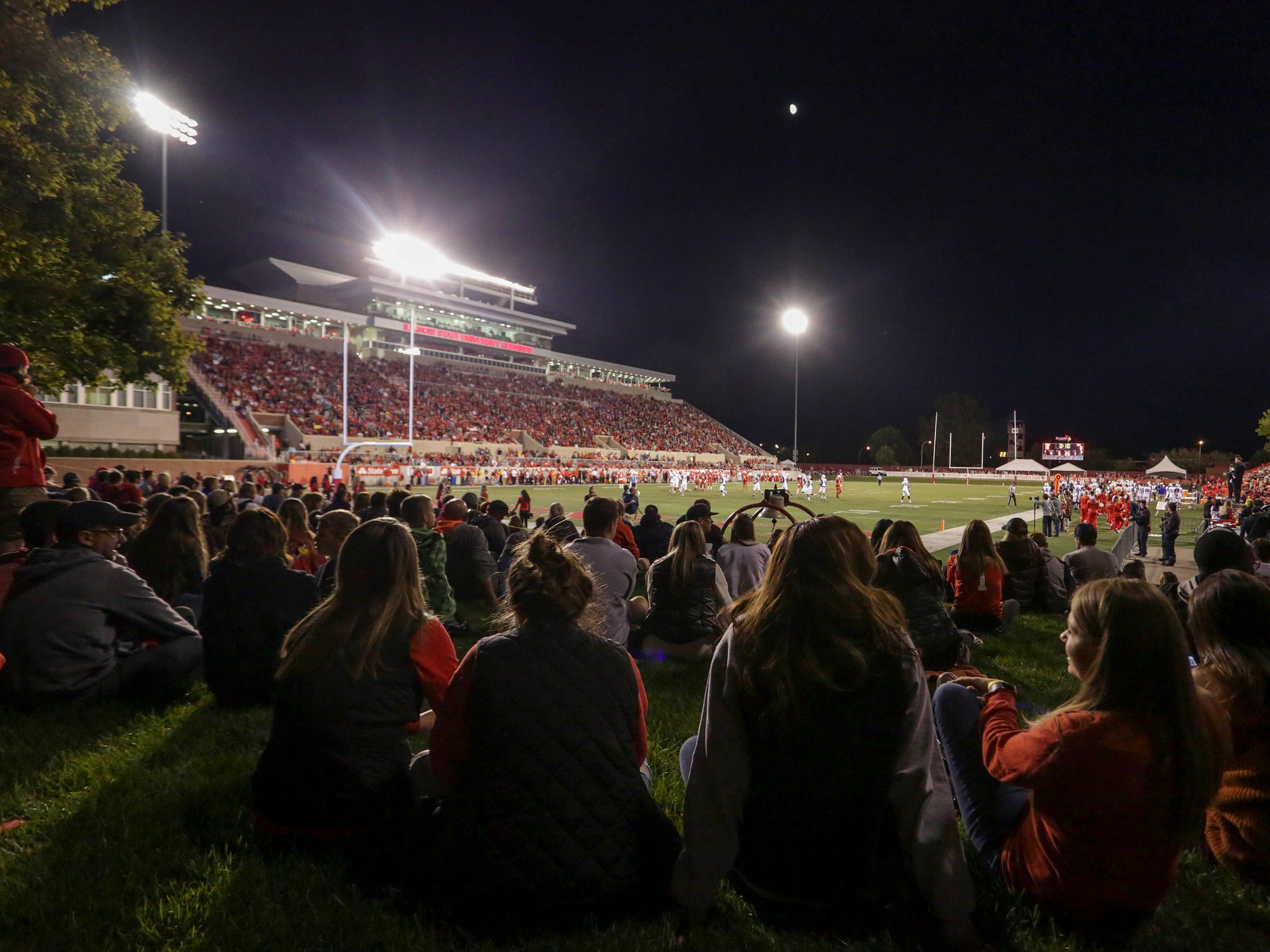 Students watching Illinois State football from the lawn seats.