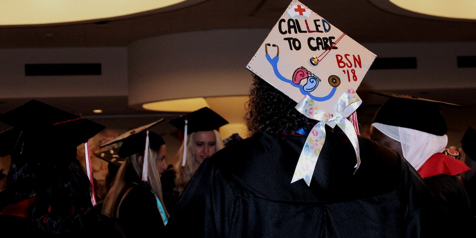 Decorated mortar board with text: called to care B.S.N. ' ...