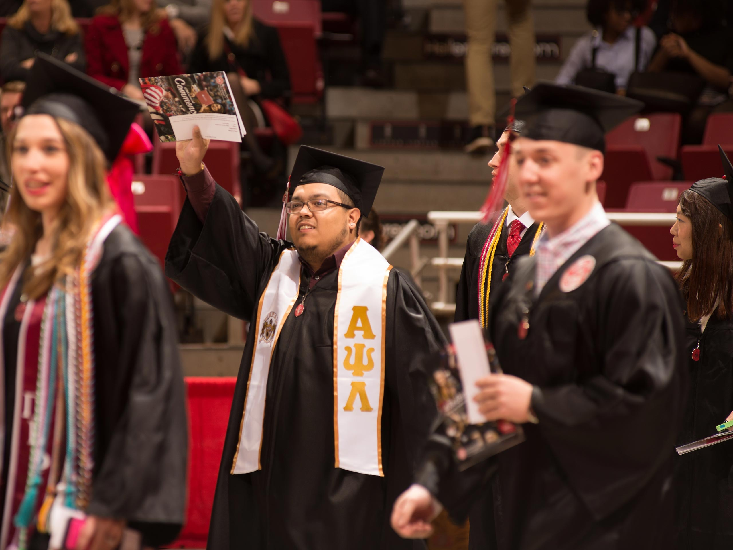 Male student walking to his seat before the commencement ceremony.