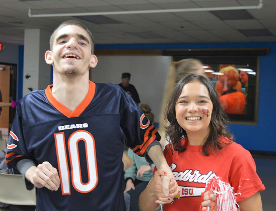 Male wearing a bears jersey and female wearing ISU gear posing and smiling for the camera.