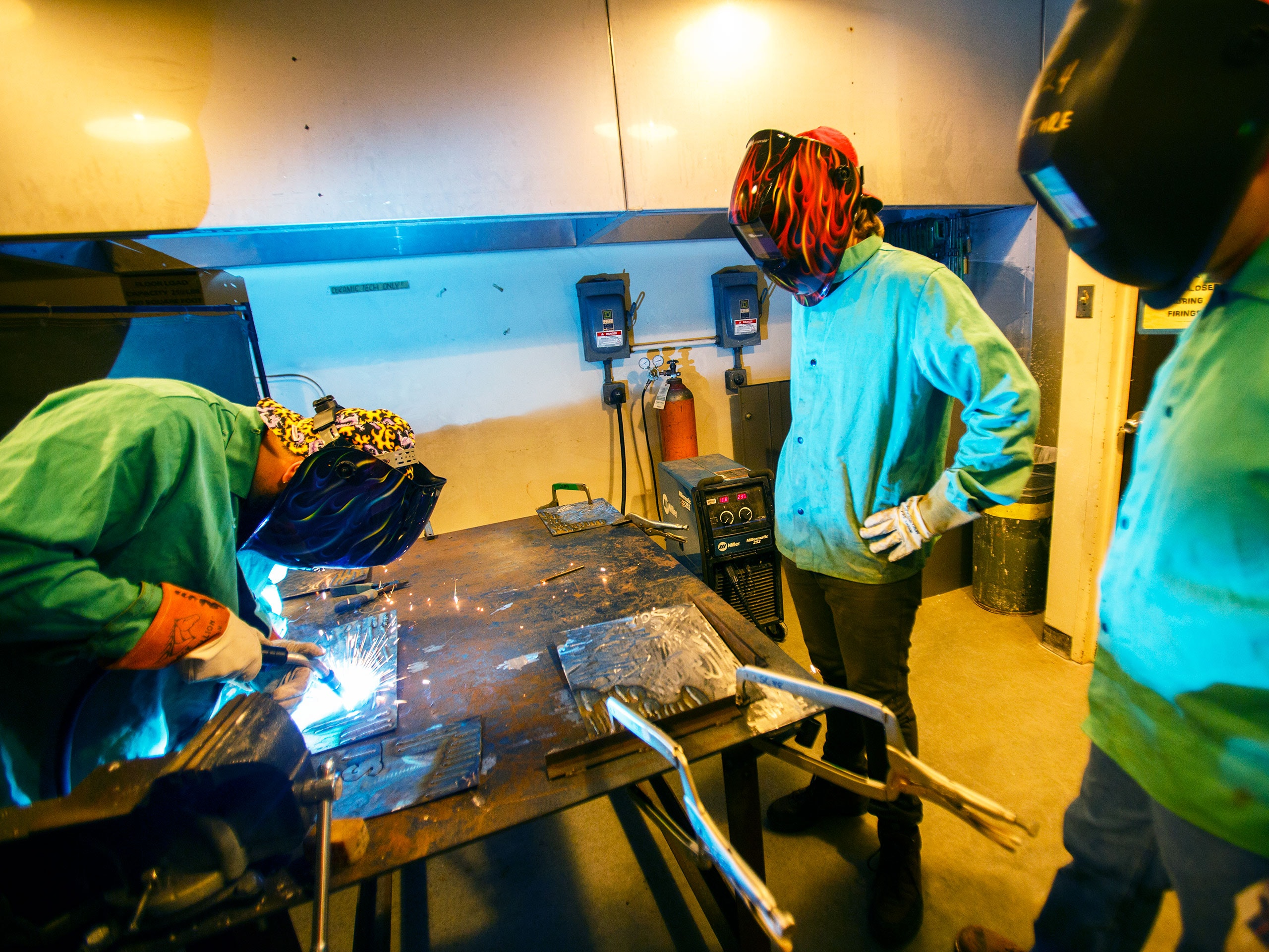 Students welding in a metals class.